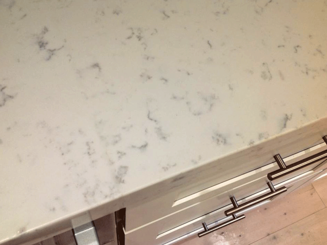 Cracked caesarstone cracked stone benchtop stone guy for Seamless quartz countertops